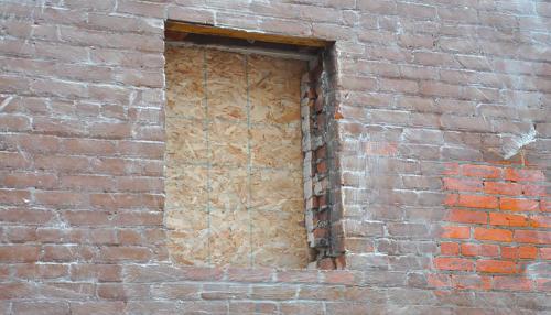 Great Lakes Concrete Restoration Monroe St Downtown Toledo Building window frame repair